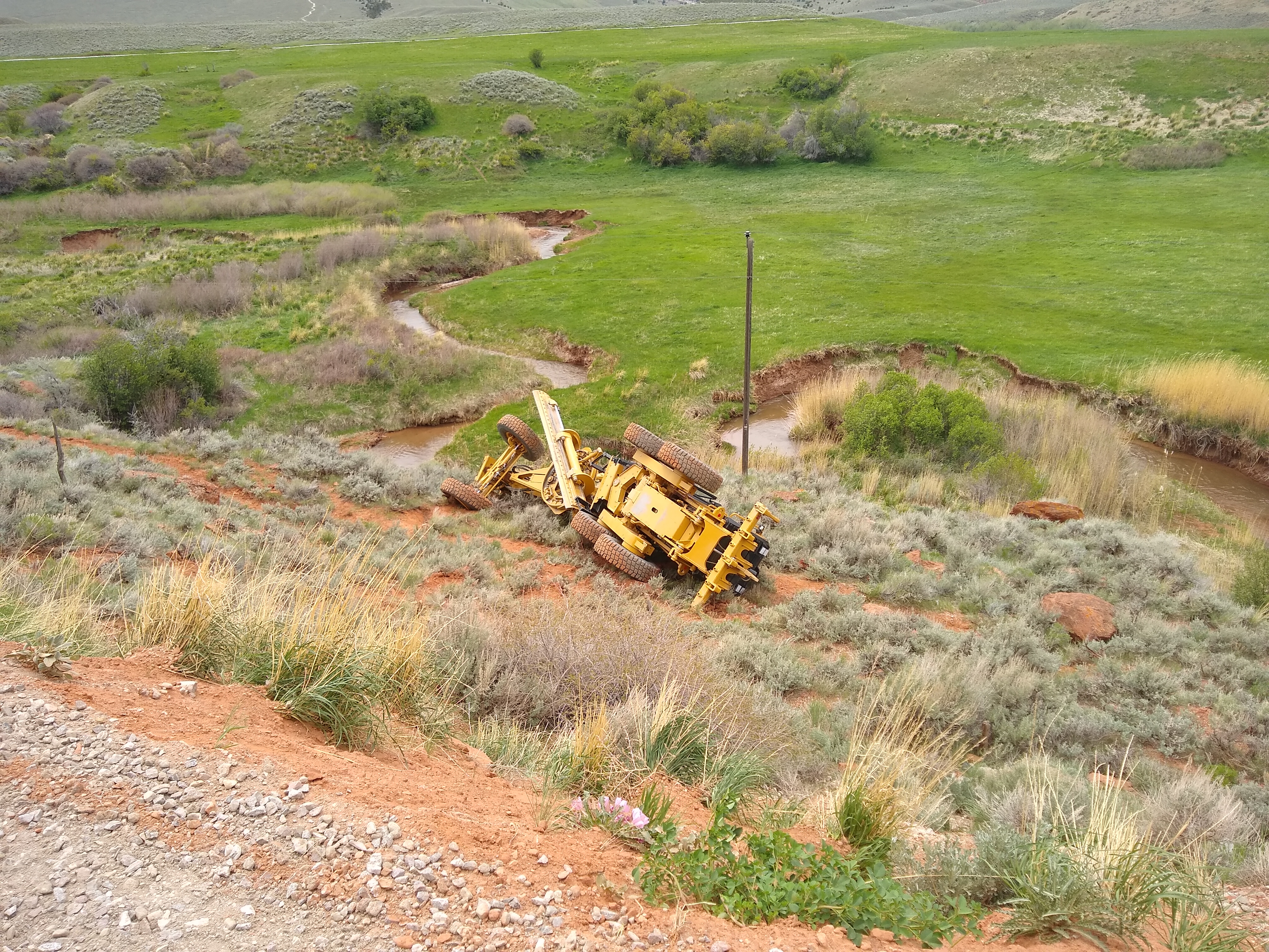 A Fremont County Road Grader rolled into ravine at Red Canyon Wednesday