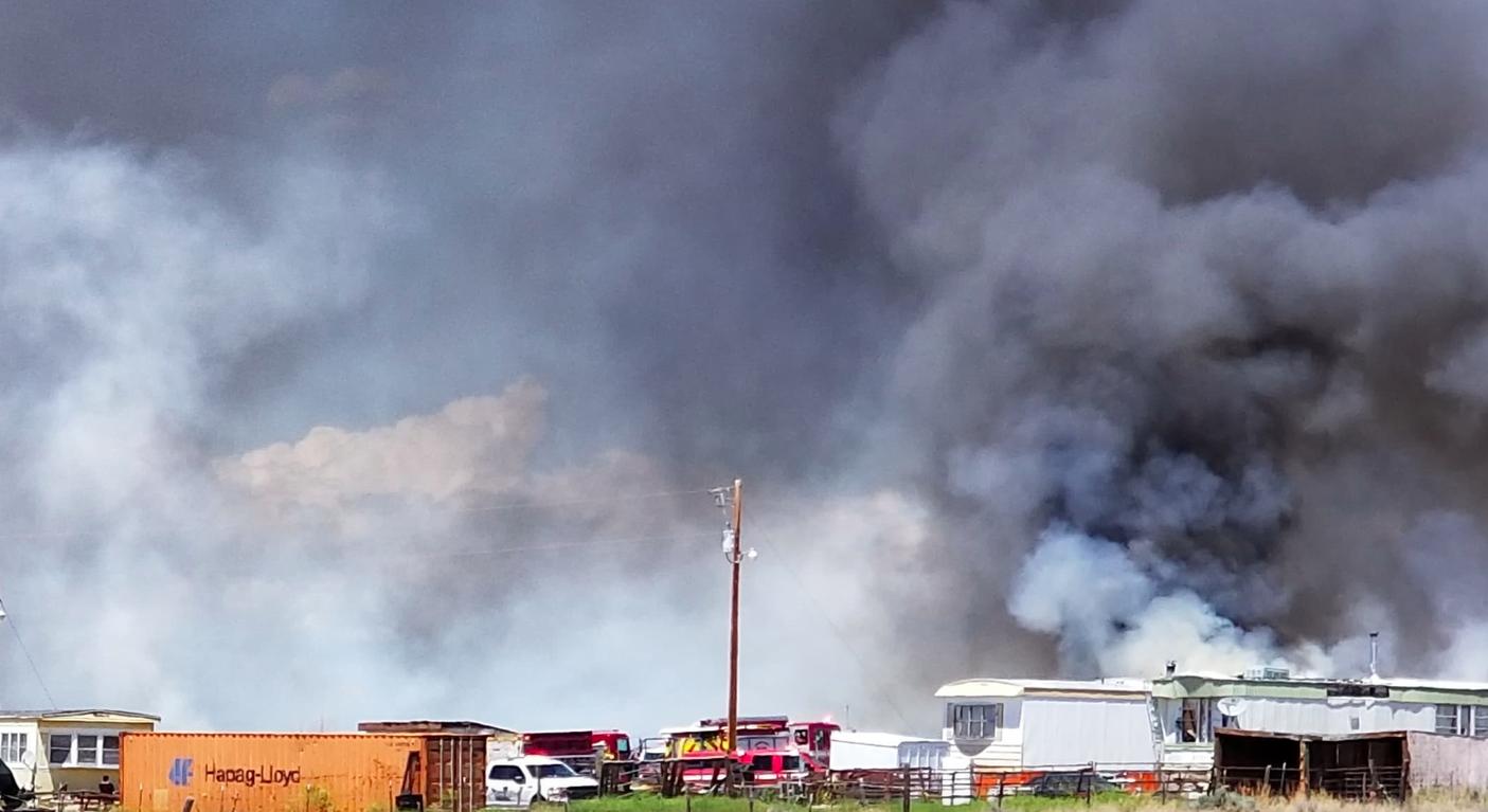 Yard fire erupted Friday alongside Highway 26 West