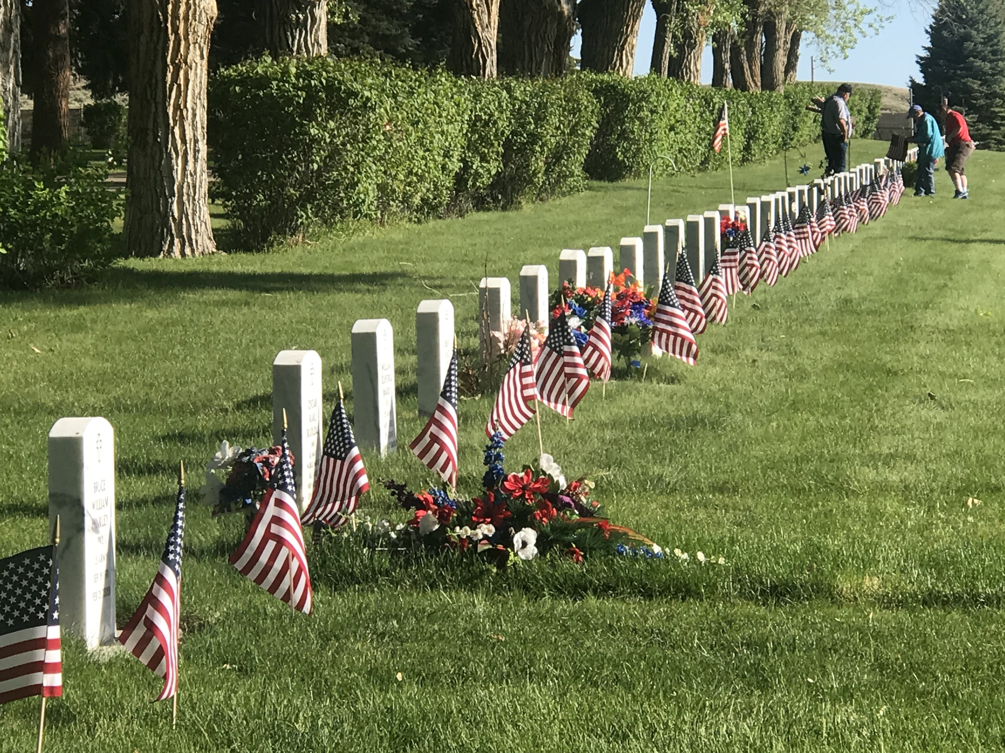 Volunteers placed flags on Graves of Veterans today